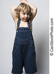 Toddle in overall - Two year old toddler wearing a jean...