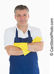 Man in apron wearing rubber gloves - Man with arms crossed...