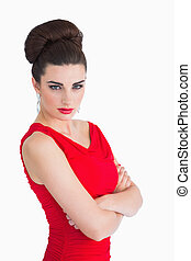 Woman in red dress having arms crossed - Glamorous woman in...