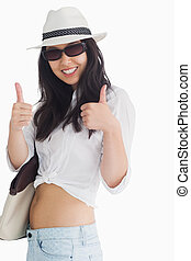 Smiling woman giving thumbs up