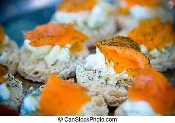 Smoked salmon hors derves with dill garnish