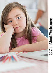 Girl sitting at kitchen looking bored - Girl sitting at...