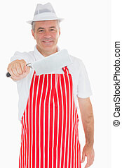 Butcher holding out meat cleaver - Smiling butcher holding...