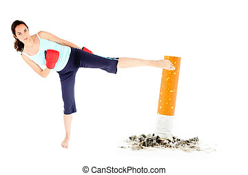 Woman kicking a giant cigarette on a white background