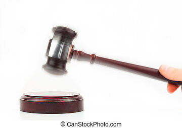 Hand using hammer and gavel