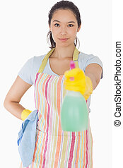 Woman spraying cleaner