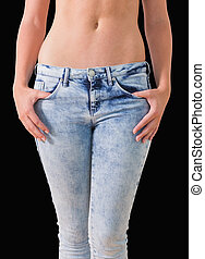 Woman holding her jeans - Close-up of woman holding her...