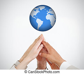 People reaching hands to globe
