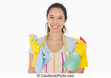 Woman holding cloth and spray bottle - Smiling woman holding...