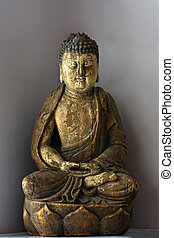 Buddha in lotus position - A wooden statue of Buddha sitting...