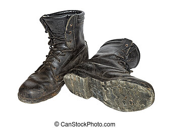Old black army boots isolated on white