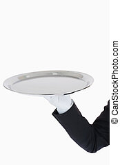 White gloved hand holding a silver tray