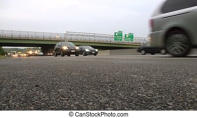 Low angle heavy traffic - Heavy freeway trafic shot from...
