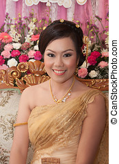 asian thai bride in thai wedding suit smiling in wedding...