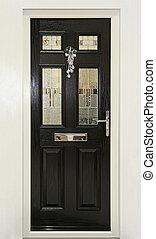 Black door - Exterior of house front door with Christmas...
