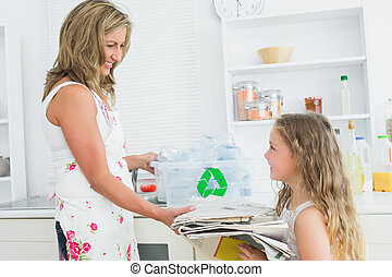 Mother taking newspaper from daughter