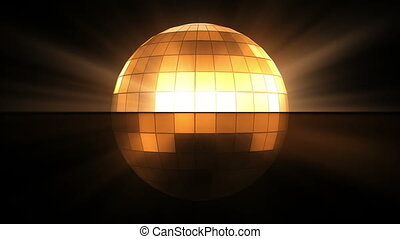 Orange disco ball against a black background
