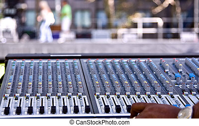 Mixing panel at a concert - A mixing panel at a live concert...