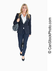 Business woman walking holding a handbag on the white...