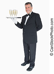 Waiter standing with tray of champagne