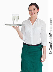 Woman in suit holding a tray with glasses