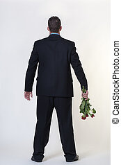 dirty rotten flowers - business man trying to give someone...