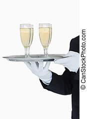 Waiter holding tray of champagne flutes on white background