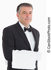 Waiter with a towel over his arm
