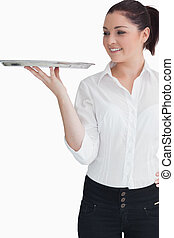 Young woman looking at the tray