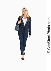 Smiling business woman walking on the white background