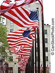 Row of American flags - Wind is blowing through a row of...