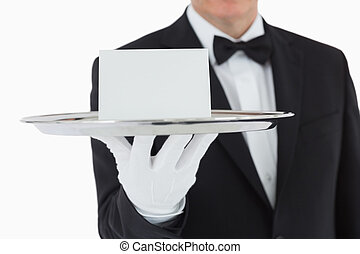 Silver tray with white card - Man holding silver tray with...