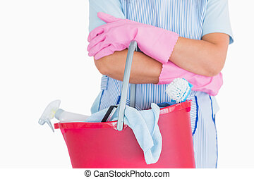 Cleaner holding a pink bucket in the white background