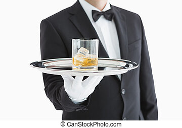 Man serving whiskey on tray - Man serving whiskey on a...