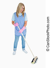 Cleaner woman sweeping the floor
