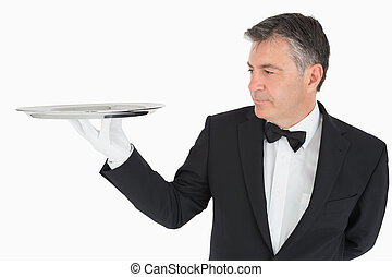 Man holding a silver tray