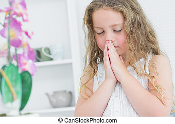 Girl praying about something