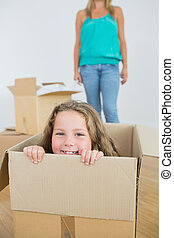 Laughing girl in moving box - Laughng girl in moving box...