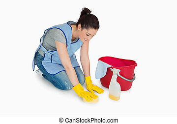 Cleaning woman washing the floor on white background