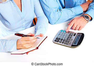 Hands of business person working with calculator - Hands of...