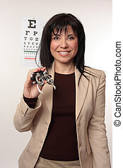Optometrist with trial frames - Optician with a friendly...