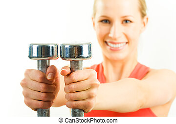 Dumbbells - Horizontal image of metal dumbbells in...