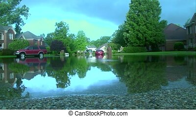 flooded suburban street - A suburban cul de sac after a...