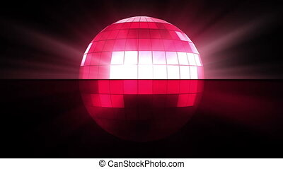 Pink disco ball against a black background