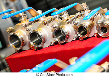 Water valves set on red tablecloth
