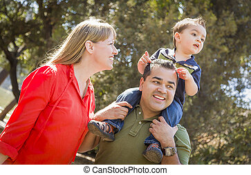 Mixed Race Family Enjoy a Walk in the Park