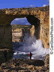 Azure Window, Gozo, Malta - Tourist taking in the dramatic...