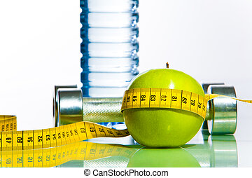 Healthy style - Green apple bounded with measuring tape with...