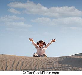 happy little girl in desert
