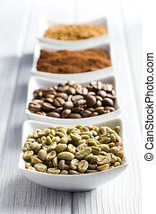 green, roasted, ground and instant coffee in ceramic bowls